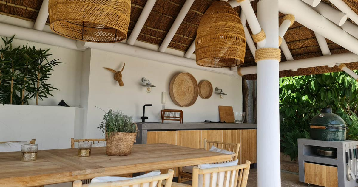 Boho chick thatched gazebo with outdoor seating area in Marbella