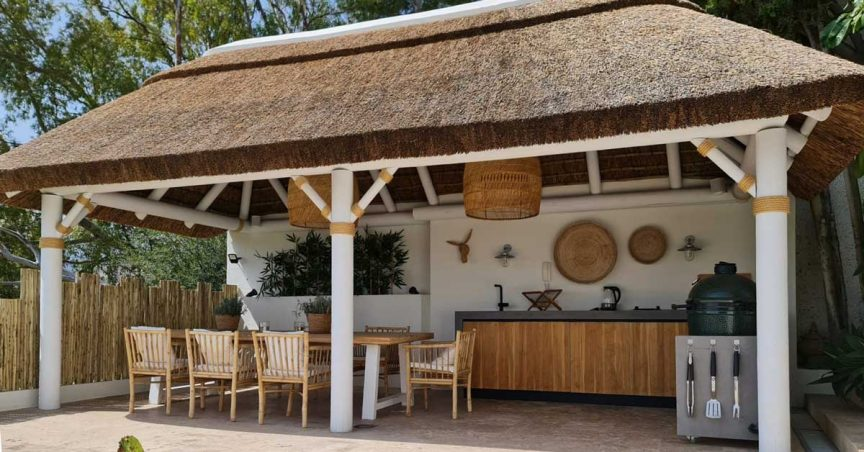 Thatched gazebo in a boho chic interior design style